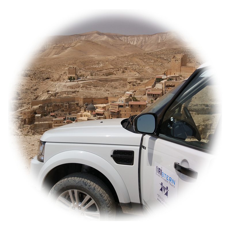 A luxurious Jeep and Marsaba monastery in the back